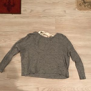 Gray open back sweater with bow